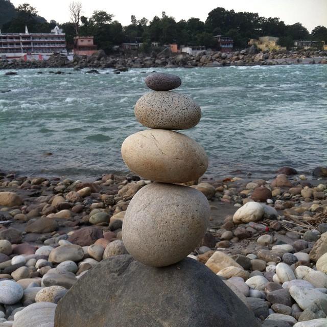 Morning meditation on the holy Ganga = playing with rock art. Surrender to the stones. #engagesurrendertransform #rishikesh #india